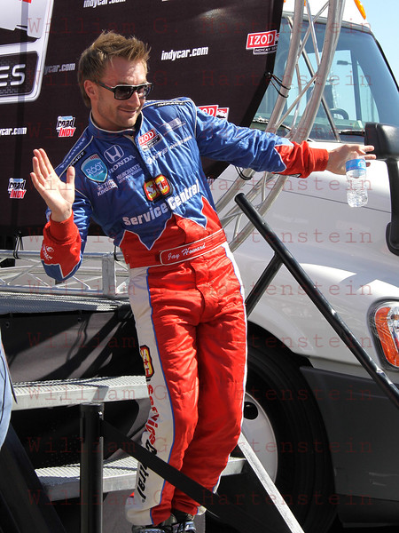 Driver Jay Howard poses for the cameras after being introduced at the Las Vegas Indy 300 Oct. 16, 2011
