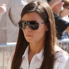 Danica Patrick leaves drivers meeting before the start of the last race of the season. Oct. 16, 2011