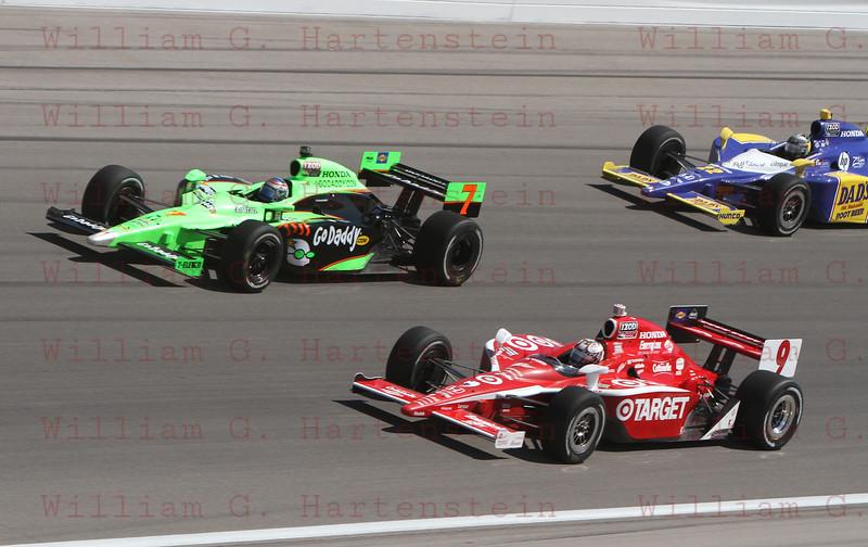 Drivers Danica Patrick #7, Scott Dixon #9 & Townsend Bell #22 battle into Turn 4 at the Las Vegas Indy 300. Oct. 16, 2011