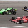 Drivers Danica Patrick #7, Scott Dixon #9 & Townsend Bell #22 battle into Turn 4 at the Las Vegas Indy 300. Oct. 16, 2011