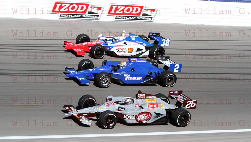 Driver's Graham Rahal #38, Oriol Servia #2 & Marco Andretti do a 5 lap tribute to Dan Wheldon.