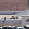 Driver Jay Howard #15 with his car still on fire finally came to a stop almost all the way down the back stretch into Turn 3 during the Las Vegas Indy 300. Oct. 16, 2011