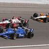Drivers Oriol Servia #2, Ryan Briscoe #6 & Alex Tagliani #98 battles into Turn 4 at the Las Vegas Indy 300. Oct. 16, 2011