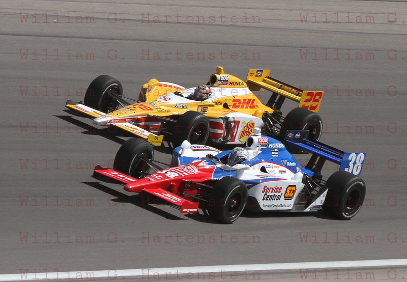 Drivers Graham Rahal #38 and Ryan Hunter-Reay #28 battle into Turn 4 at the Las Vegas Indy 300. Oct. 16, 2011