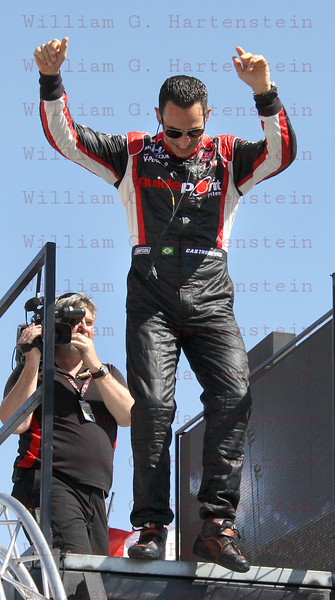 Driver Helio Castroneves after being introduced before the Las Vegas Indy 300 Oct. 16, 2011