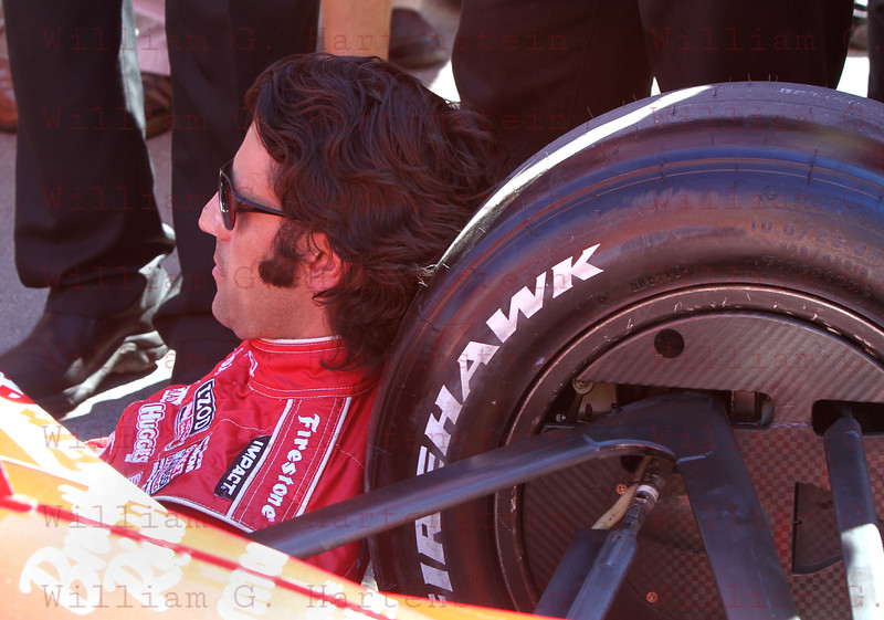 Dario Franchitti takes a break before getting in his Target race car. LVMS 10-16-2011