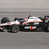 Driver Will Power enters into Turn 4 1/2 lap before going airbourne and crashing at the Las Vegas Indy 300. Oct. 16, 2011