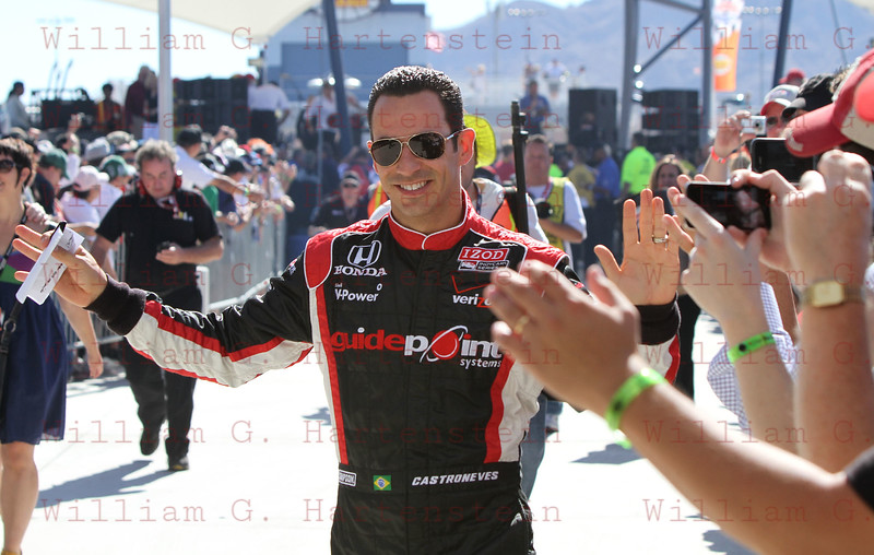Helio Castroneves leaves drivers meeting before the start of the last race of the season. Oct. 16, 2011