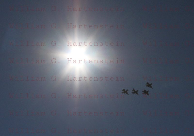 Four F-16's do a fly-by at the start of the Las Vegas Indy 300. Oct. 16, 2011
