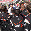 Crew Chief Tim Cindric gaves a pep talk to Team Penske and Driver Will Power on the grid before the start of the Las Vegas Indy 300. Oct. 16, 2011