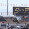 Las Vegas Indy 300 crash in turn 2 that took the life of Dan Weldon (#77). Weldon's car is upside down over the #59 car of E.J. Viso. Oct. 16, 2011
