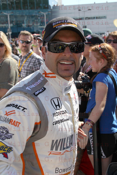 Driver Alex Tangliani teammate of Dan Wheldon after being introduced before the Las Vegas Indy 300 Oct. 16, 2011