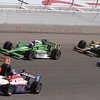 Drivers Alex Lloyd #19, Charlie Kimall #83,Tomas Scheckter #57, Jay Howard #15 & Paul Tracy #8 battles into Turn 4 at the Las Vegas Indy 300. Oct. 16, 2011