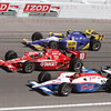 Dario Franchitti #10 splits Alex Lloyd #19 & Townsend Bell #22 at 224mph entering Turn 4 at the Las Vegas Indy 300. Oct 16, 2011