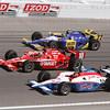 Dario Franchitti #10 splits Alex Lloyd #19 & Townsend Bell #22 at 224mph entering Turn 4 at the Las Vegas Indy 300. Oct 16, 2011