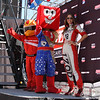 Indy Car Series IZOD Girl, Firestone Mascot and Las Vegas Mascot wait to greet drivers of the Las Vegas Indy 300, Oct. 16, 2011