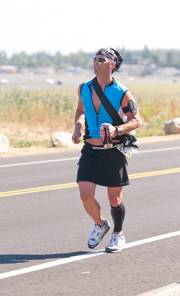 Brian from the Running on Fumes Ultra team bring it along the beach in Bellingham