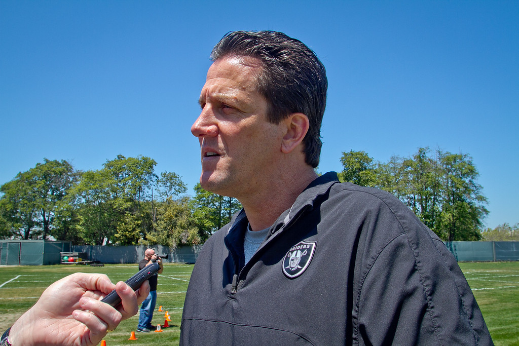 Raider offensive coordinator Greg Knapp talks to reporters after a rookie minicamp at the Raider training facility in Alameda, Calif.,  on Saturday, May 12th, 2012.