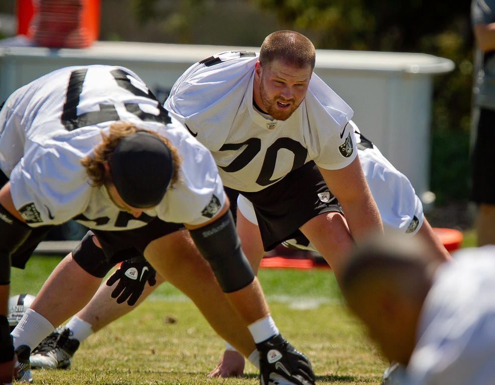 Raider offensive lineman Tony Bergstrom stretches during a rookie minicamp at the Raider training facility in Alameda, Calif., on Saturday, May 12th, 2012.