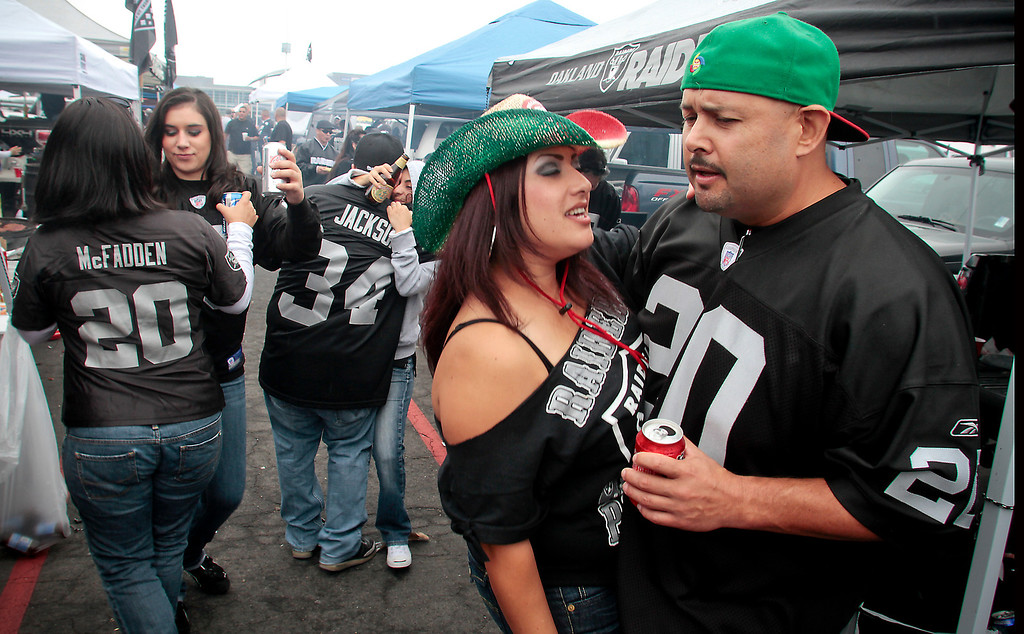 Daniel and Petra Murillo of Stockton dance in the parking lot before the Raiders-Jets game at the Oakland Coliseum, Calif., on Sunday, September 25,  2011.