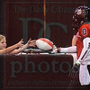 Matt Hamilton/The Daily Citizen<br /> After scoring a touchdown on the opening play of the game, Micheal Figgers hands the ball to McKinley Staten, 11, as she watches the game from the sidelines Thursday.