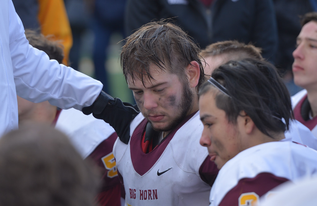 Justin Sheely   The Sheridan Press<br /> Big Horn's Jaxon Parker and the team listen to head coach Michael McGuire after the Hornets claim the Class 1A State Title Saturday, November 11, 2017, at War Memorial Stadium in Laramie. The Rams lost 20-16 to Pine Bluffs to take runner-up in the championship.