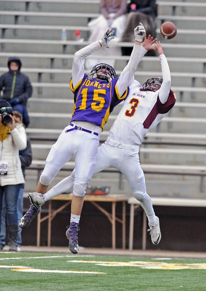 Big Horn's Carson Bates (3) jumps with Pine Bluffs' Colby Lamb for a deep pass during the 1A state championship on Saturday, Nov. 11 at War Memorial Stadium. Mike Pruden | The Sheridan Press