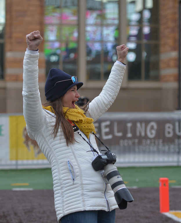 Justin Sheely | The Sheridan Press<br /> Big Horn photographer Gretchen McCafferty celebrates a Rams touchdown during the Class 1A State Championship Saturday, November 11, 2017, at War Memorial Stadium in Laramie. The Rams lost 20-16 to Pine Bluffs to take runner-up in the championship.