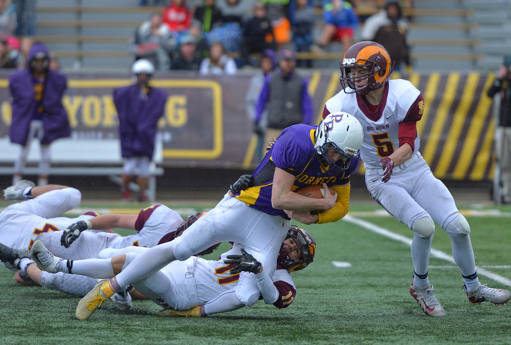 Justin Sheely | The Sheridan Press<br /> Big Horn's Brock Michaud (11) and Will Pelissier stop Haize Fornstrom's keeper run during the Class 1A State Championship Saturday, November 11, 2017, at War Memorial Stadium in Laramie. The Rams lost 20-16 to Pine Bluffs to take runner-up in the championship.
