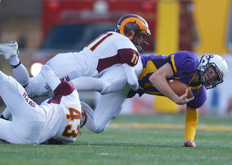 Justin Sheely | The Sheridan Press<br /> Big Horn's Jack Nance (43) and Brock Michaud tackle Hornets' quarterback Haize Fornstrom on a run during the Class 1A State Championship Saturday, November 11, 2017, at War Memorial Stadium in Laramie. The Rams lost 20-16 to Pine Bluffs to take runner-up in the championship.