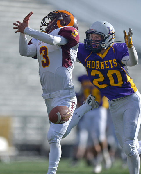 Justin Sheely | The Sheridan Press<br /> Big Horn's Carson Bates reaches for a pass over-thrown with Hornets' Andrew Fornstrom during the Class 1A State Championship Saturday, November 11, 2017, at War Memorial Stadium in Laramie. The Rams lost 20-16 to Pine Bluffs to take runner-up in the championship.
