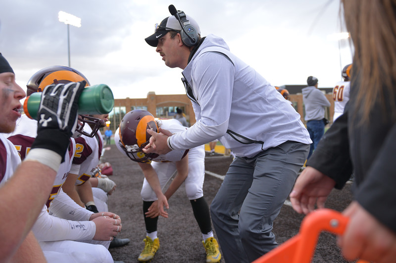 Justin Sheely | The Sheridan Press<br /> Big Horn assistant coach Andrew Marcure rallies the defensive line during a timeout in the final quarter of the Class 1A State Championship Saturday, November 11, 2017, at War Memorial Stadium in Laramie. The Rams lost 20-16 to Pine Bluffs to take runner-up in the championship.