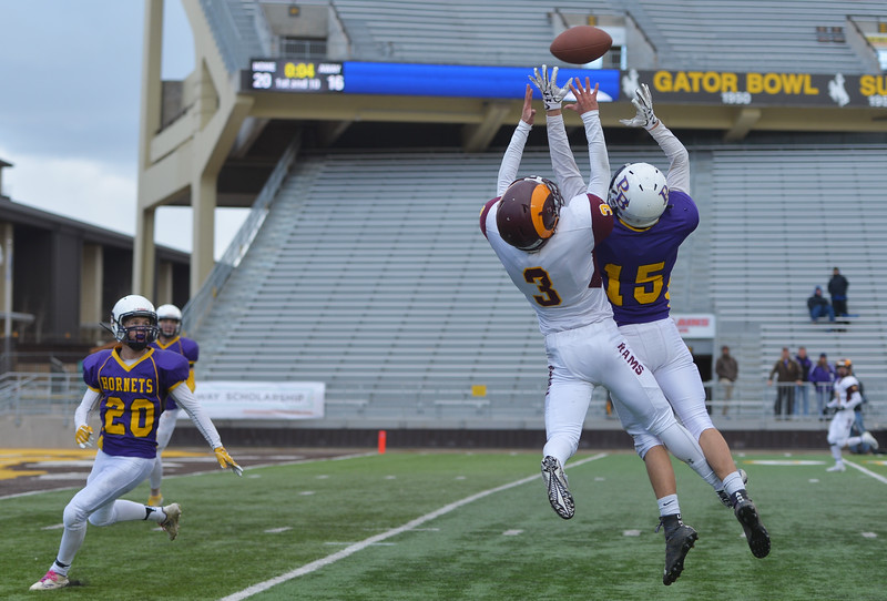 Justin Sheely | The Sheridan Press<br /> Big Horn's Carson Bates (3) just cannot reach a long pass attempt in the final quarter of the Class 1A State Championship Saturday, November 11, 2017, at War Memorial Stadium in Laramie. The Rams lost 20-16 to Pine Bluffs to take runner-up in the championship.