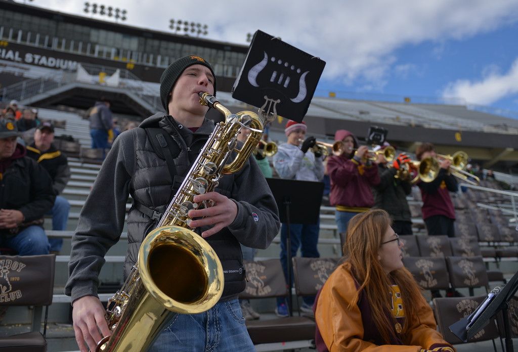 Justin Sheely | The Sheridan Press<br /> Big Horn band member Elijah Phillips plays the Baritone Saxophone during the Class 1A State Championship Saturday, November 11, 2017, at War Memorial Stadium in Laramie. The Rams lost 20-16 to Pine Bluffs to take runner-up in the championship.