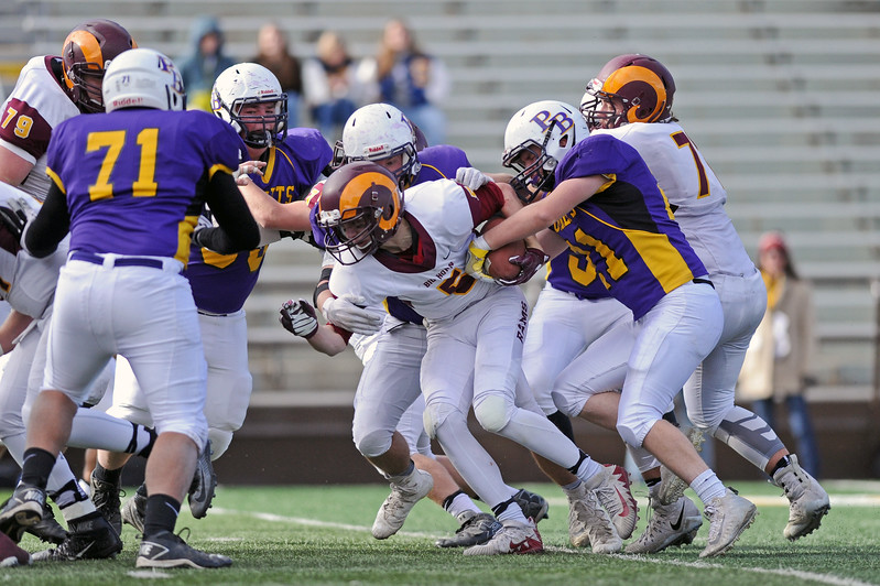 The Pine Bluffs defense tries to strip the ball from Big Horn running back WIll Pelissier during the 1A state championship on Saturday, Nov. 11 at War Memorial Stadium. Mike Pruden | The Sheridan Press