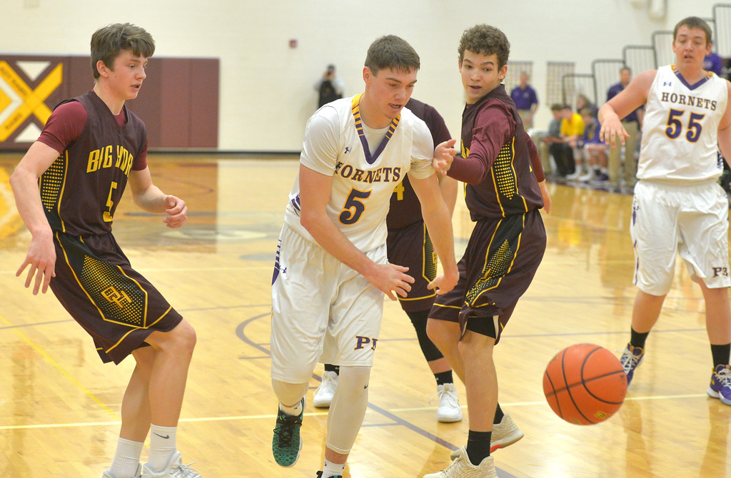 Justin Sheely | The Sheridan Press<br /> Pine Bluffs' Haize Forstrom, center, strips the ball from Big Horn's Will Pelissier, left, as Kade Vandyken looks on at Big Horn High School Friday, Jan. 5, 2018. The Rams lost to Pine Bluffs 59-41.