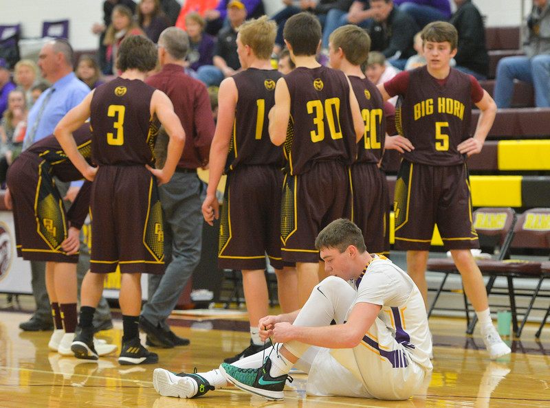 Justin Sheely | The Sheridan Press<br /> Pine Bluffs' Haize Fornstrom ties his shoe after the Rams call a timeout at Big Horn High School Friday, Jan. 5, 2018. The Rams lost to Pine Bluffs 59-41.