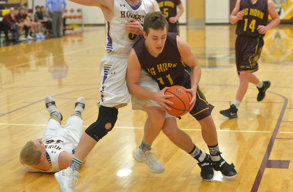 Justin Sheely | The Sheridan Press<br /> Big Horn's Cutler Bradshaw drives against Pine Bluffs at Big Horn High School Friday, Jan. 5, 2018. <br /> The Rams lost to Pine Bluffs 59-41.