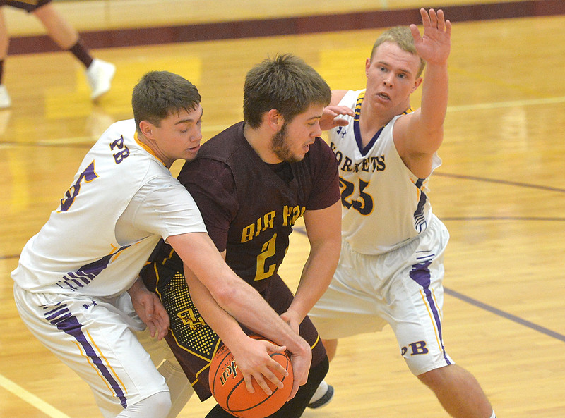 Justin Sheely | The Sheridan Press<br /> Big Horn's Jaxon Parker loses the ball to Hornets' Haize Fornstrom, left, and Hunter Jeffres at Big Horn High School Friday, Jan. 5, 2018. The Rams lost to Pine Bluffs 59-41.