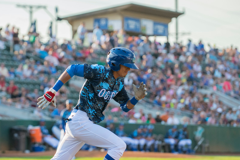 Raptors player Moises Perez (6) gets a hit but is thrown out on first with a record breaking attendance crowd watching at Lindquist Field in Ogden on Friday July 14, 2017. The Raptors vs the Missoula Osprey.