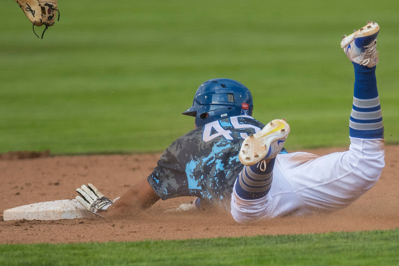 Gersel Pitre (45)  slides into first and then the ball is overthrown, so he runs to second and is called safe after slide at Lindquist Field in Ogden on Friday July 14, 2017.
