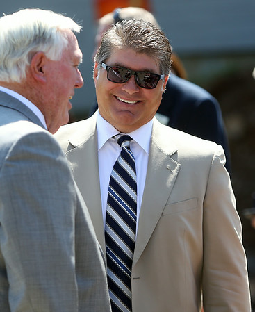Boston Bruins legend Ray Bourque smiles while chatting with Endicott College President Richard Wylie prior to the start of a groundbreaking ceremony for the new ice rink at the college which will be named after the great Bruins defenseman. DAVID LE/Staff photo. 7/29/14.