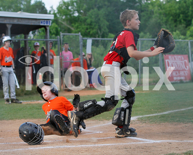 O's Joe Alford scores the go-ahead run in the bottom of the first as Card's catcher Conner Howard waits for the throw.
