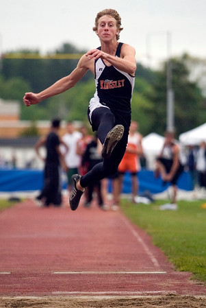 Record-Eagle/Jan-Michael Stump<br /> Kingsley's Nolan Stiner jumps 19 feet 9 inches in the long jump.