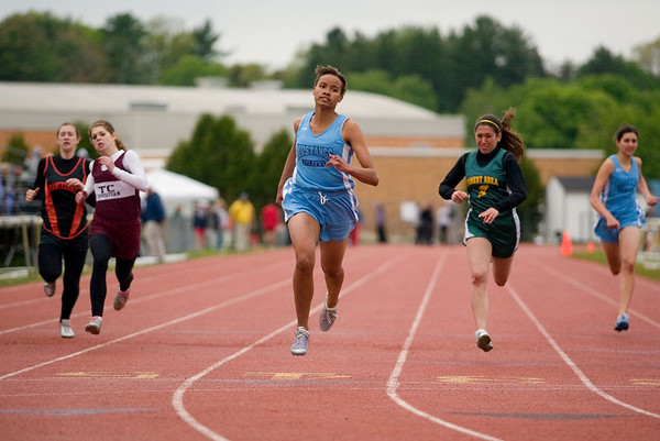 Record-Eagle/Jan-Michael Stump<br /> Grand Traverse Academy's Rachel Zeppa, center, wins the 200 meter dash.