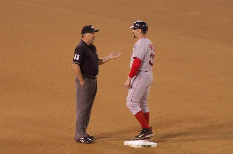 Jason Varitek talks to the 2nd Base ump during a pitching change