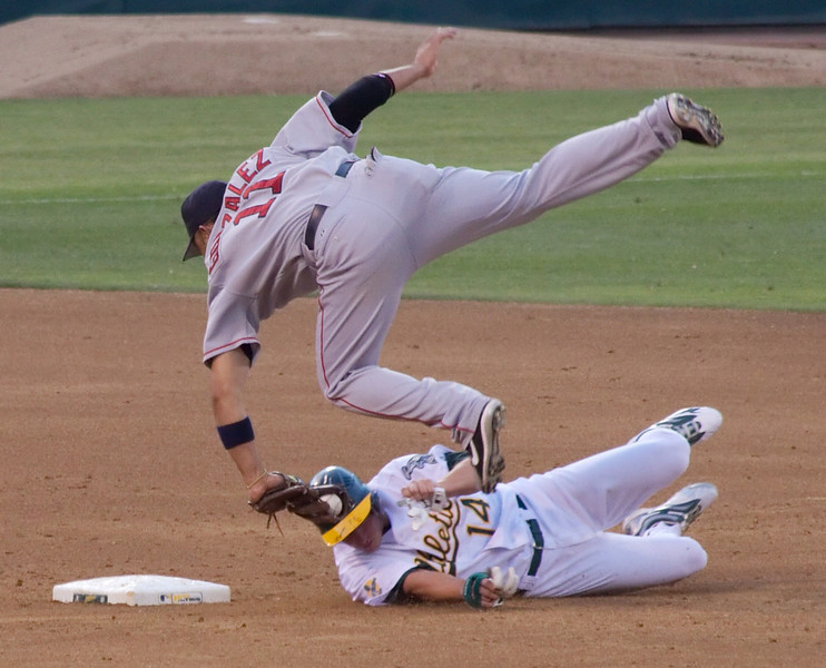 Gonzalez gets knocked over at 2nd...