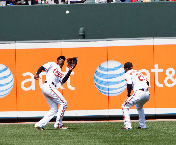 Adam Jones about to make a catch as Nick Markakis looks on during a Red Sox - Orioles game at Camden Yards on July 20, 2011.