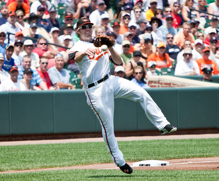 Mark Reynolds making a throw to first during a Red Sox - Orioles game at Camden Yards on July 20, 2011.