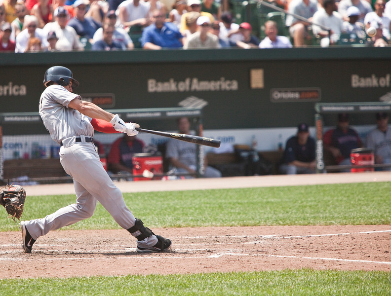 Jacoby Ellsberry just after making contact for a home run (look in right upper corner) during a Red Sox - Orioles game at Camden Yards on July 20, 2011.
